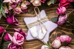 Scented Stone as a Gift for Baby Shower. On wooden background royalty free stock images