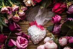 Scented Stone as a Gift for Baby Shower. On wooden background royalty free stock photos