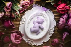 Scented Stone as a Gift for Baby Shower. On wooden background stock photography