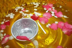 Scented water, flowers and silver bowl. Songkran festival Thailand. Silver bowl for bathing Buddha image in Songkran festival Thailand royalty free stock photography