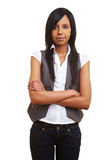 Sceptical african girl with arms Stock Photography