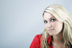 Sceptical beautiful young woman Royalty Free Stock Images