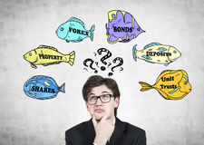 Sceptical broker and forex fish Royalty Free Stock Images