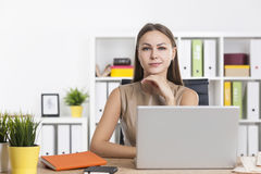 Sceptical businesswoman in colorful office Stock Photography