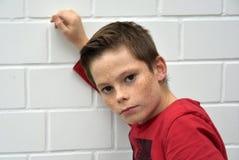 Sceptical looking teenager boy Stock Photo