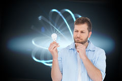 Sceptical model holding a bulb Stock Photos