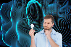 Sceptical model holding a bulb Stock Images