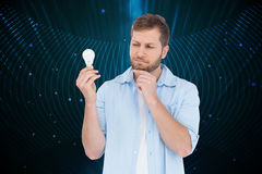 Sceptical model holding a bulb Stock Photography