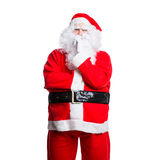 Sceptical santa claus. Isolated on white Royalty Free Stock Photo