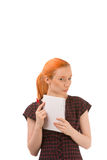 Sceptical young redhead secretary Royalty Free Stock Photo