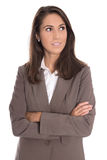 Sceptically isolated business woman in brown blazer looking side Stock Photo
