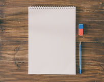 Scetch Idea Concept. White paper and pen for scetch on the wood background Royalty Free Stock Images