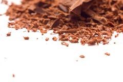 Schäbige Schokolade auf einem weißen Hintergrund stockfotos