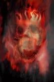 Schädel auf Feuer Stockbilder