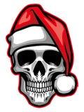 Schädel, der Weihnachtsmann-Hut trägt Stockbilder