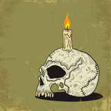 Schädel mit Kerze Stockfoto