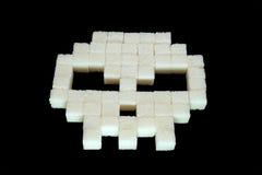 Schädel von den Würfeln des raffinierten Zuckers diabetes Lizenzfreie Stockfotos