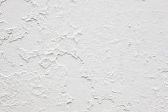 Schädigende strukturierte weiße Wand Gebrochenes Material aufbau Stockbilder