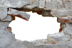 Schädigende Wand mit formlosem Loch Stockfotografie