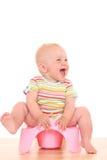 Schätzchen auf potty Lizenzfreies Stockbild