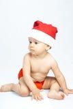 Schätzchen, das Weihnachtsmann-Hut trägt Lizenzfreie Stockbilder