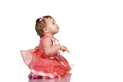 Schätzchen im rosafarbenen Kleid stockfotos