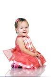 Schätzchen im rosafarbenen Kleid stockfoto