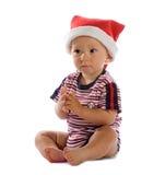 Schätzchen im Weihnachtsmann-Hut Lizenzfreies Stockbild