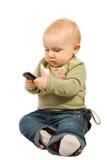 Schätzchen mit Mobiltelefon Stockbilder