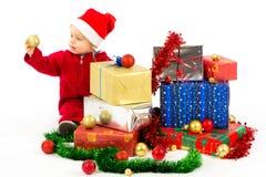 Schätzchen mit Weihnachtsgeschenken Lizenzfreies Stockbild