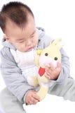 Schätzchen und Spielzeug Stockbild