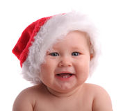 Schätzchenkind in einem Weihnachtshut stockfotografie
