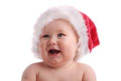 Schätzchenkind in einem Weihnachtshut lizenzfreies stockfoto