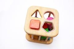 Schätzchenpuzzlespielform-Blockspielzeug Lizenzfreie Stockfotos