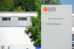 Schön Klinik Roseneck. Sign infront of the Schön clinic in Rosenheim with copy space Royalty Free Stock Photography