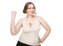 Schön plus die Größenfrau, die Erfolg feiert lizenzfreie stockfotos
