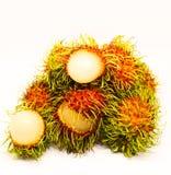 Schön vom roten Rambutan auf weißem Hintergrund Lizenzfreie Stockfotografie