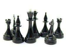 Schön von den Schachstücken auf einer Weißrückseite Stockfotos