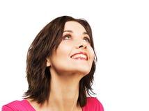 Schöne angespornte Frau schaut oben Stockfotografie