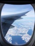 Schöne Ansicht von einem Fensterplatz eines Passagierflugzeugs Stockfotos