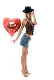 Schöne Art und Weisefrau mit einem roten Partyballon. stockfoto