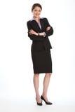 Schöne asiatische Frau in den Anzugarmen gefaltet Lizenzfreies Stockfoto
