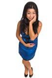 Schöne asiatische Frau in einem blauen Kleid Stockbilder