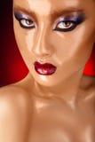 Schöne asiatische Frau mit nassem Gesicht Stockbild