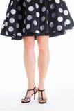 Schöne Beine, nettes Kleid Stockbilder