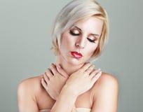 Schöne blonde Frau Stockbild