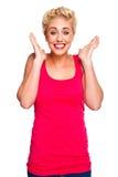 Schöne blonde Frau, die überrascht schaut Lizenzfreies Stockfoto