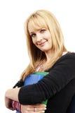 Schöne blonde Frau, die einige Dateien anhält Lizenzfreies Stockbild