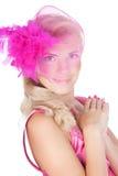 Schöne blonde Frau in einem rosafarbenen Hut Lizenzfreies Stockfoto