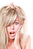 Schöne blonde Frau entsetzt Stockfotos